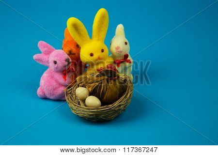 Figurines Easter Bunnies And Hen On A Nest
