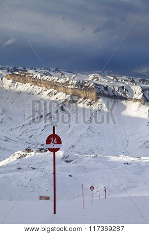 Ski Slope At Evening And Storm Sky