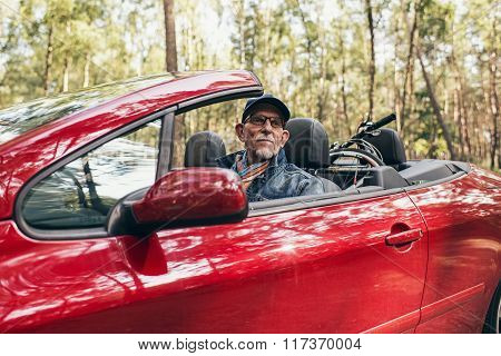 Active Retired Man In Cabriolet Car Enjoying Nature.
