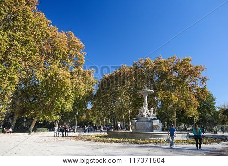 MADRID SPAIN - NOVEMBER 14 2015: Sculpted Fountain in the Buen Retiro Park one of the main attractions of Madrid Spain.