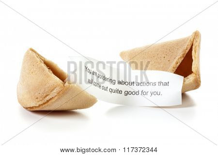 Broken fortune cookie, message slip predicting positive future
