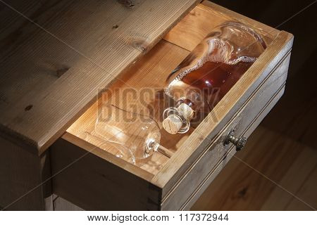 Bottle Brandy And Glasses In A Drawer