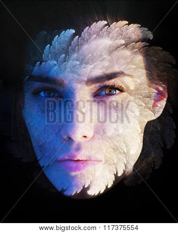 Portrait of gorgeous woman combined with the fractal in the double exposure technique