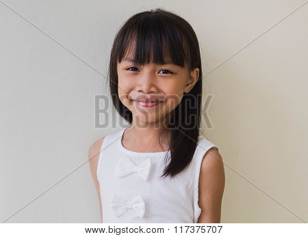Happy Little Asian Girl  Isolated In White