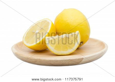 Lemons In Wood Dish Isolated On White
