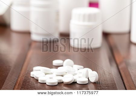 White Pills And Pill Bottles