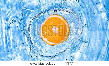 Fresh orange dropped into water with bubbles. Header for website
