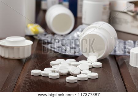 White pills,empty blister pack and pill bottles