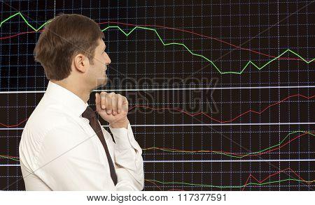 Businessman stock trader looking at monitors