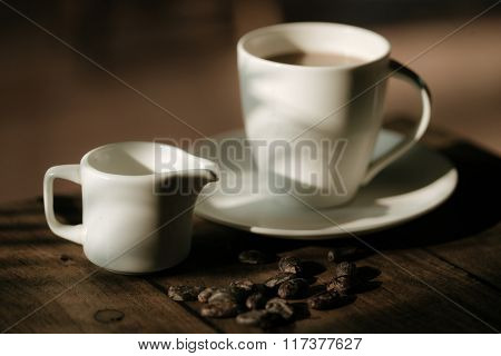 Cup of coffee and chocolate beans