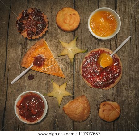 Cakes upside with carambola on wooden table