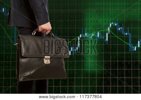 Exchange broker. Businessman with briefcase against the background of the exchange panel
