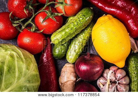 Assortment of fresh vegetables close up on black table