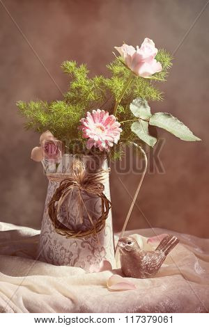 Flower arrangement for Mothers Day with pink roses and vintage tone