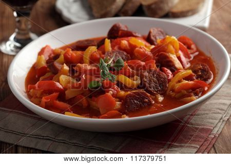 Traditional Hungarian Lecso with spiced sausage on a plate