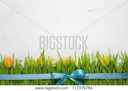 Easter eggs in the grass with ribbon bow
