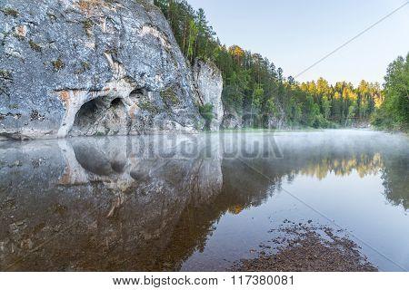 wooden suspension bridge over the river