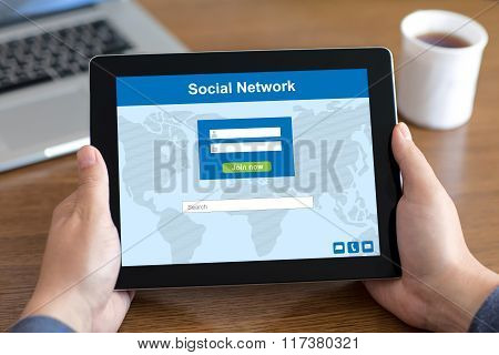 Male Hands Holding Tablet With Social Network On The Screen