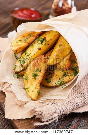 Potato Wedges On Wooden Background