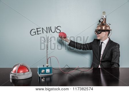 Genius concept with businessman holding brain