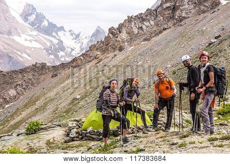 Alpine climbers team and camp