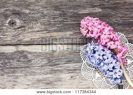 Fresh Hyacinth Flowers On Aged Wooden Background. Top View