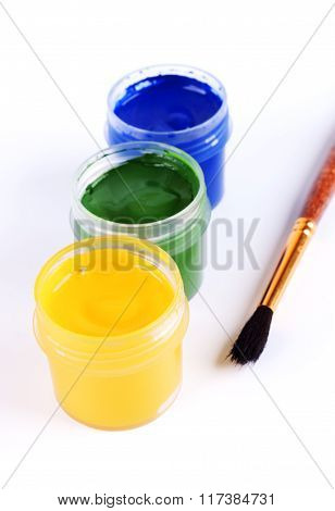 Jars With Colored Gouache And Paint Brushes.
