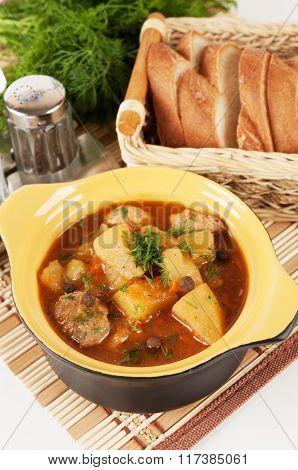 Stewed Potatoes In A Ceramic Pot.