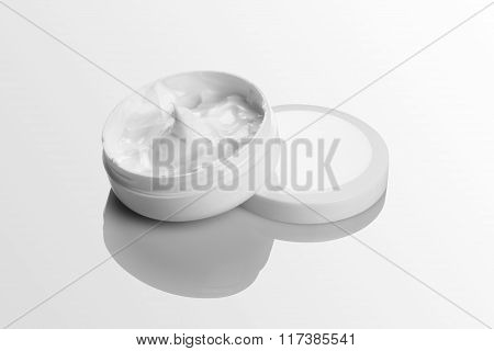 Cosmetic Cream Pack Mockup On White Reflective Background