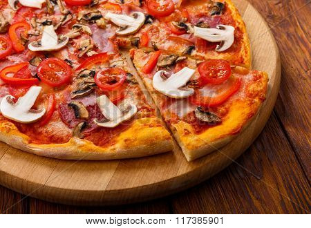 Delicious Pizza With Mushrooms, Peppers And Pepperoni