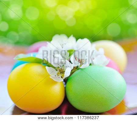 Colored Easter Eggs With White Flowers With Space For Text