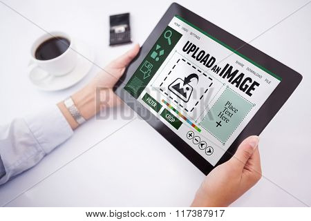 Man using tablet pc against designer interface