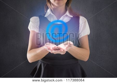 Businesswoman presenting against grey room