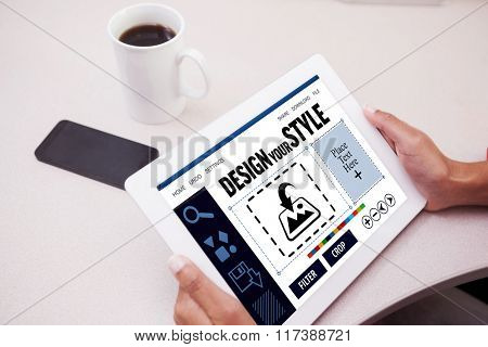 Woman using tablet pc against designer interface