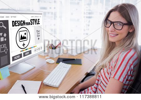 Attractive photo editor working on computer against designer interface