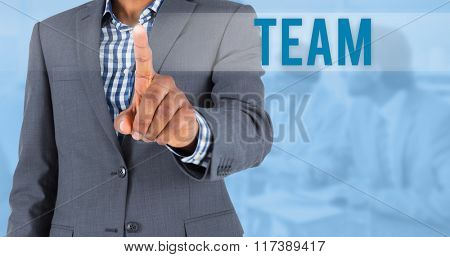 The word team and focused businessman pointing against blue background