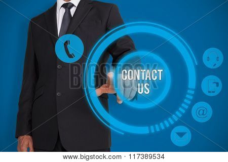Businessman pointing against royal blue