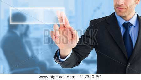 Businessman pointing these fingers at camera against blue background
