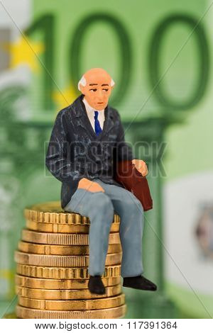 pensioners sitting on money stack