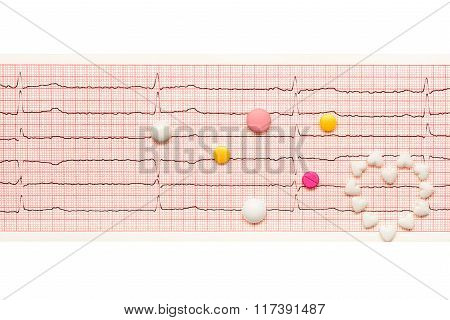 Heart Made Of Tablets And Tablets On Paper Ecg Results