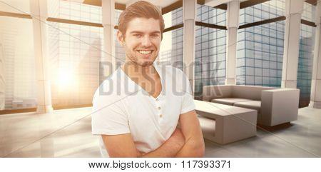 Handsome man against modern room overlooking city