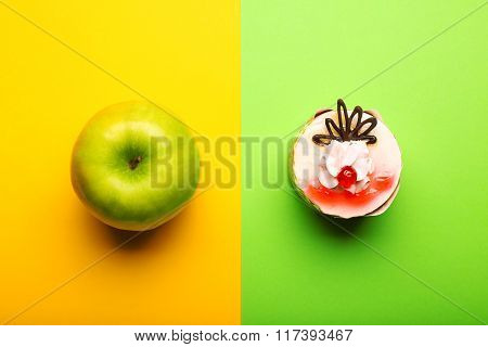 Green Apple And Tasty Cake On Colorful Background