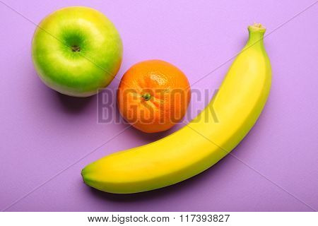 Fresh Fruits On Bright Purple Background