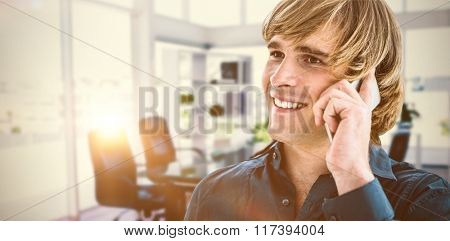 Hipster businessman talking on the phone against board room