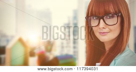 Portrait of a smiling hipster woman against view of a business desk
