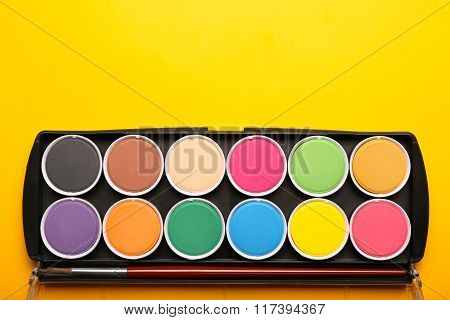 Watecolor In Box On Yellow Background