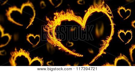 Several heart in fire against black