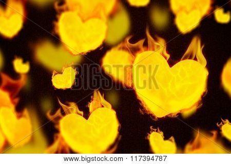 Several heart on fire against dark background