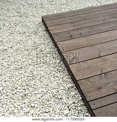 Wooden Deck And White Decorative Stones