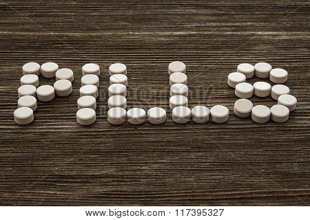 Medical pill on wooden table. Close up photo